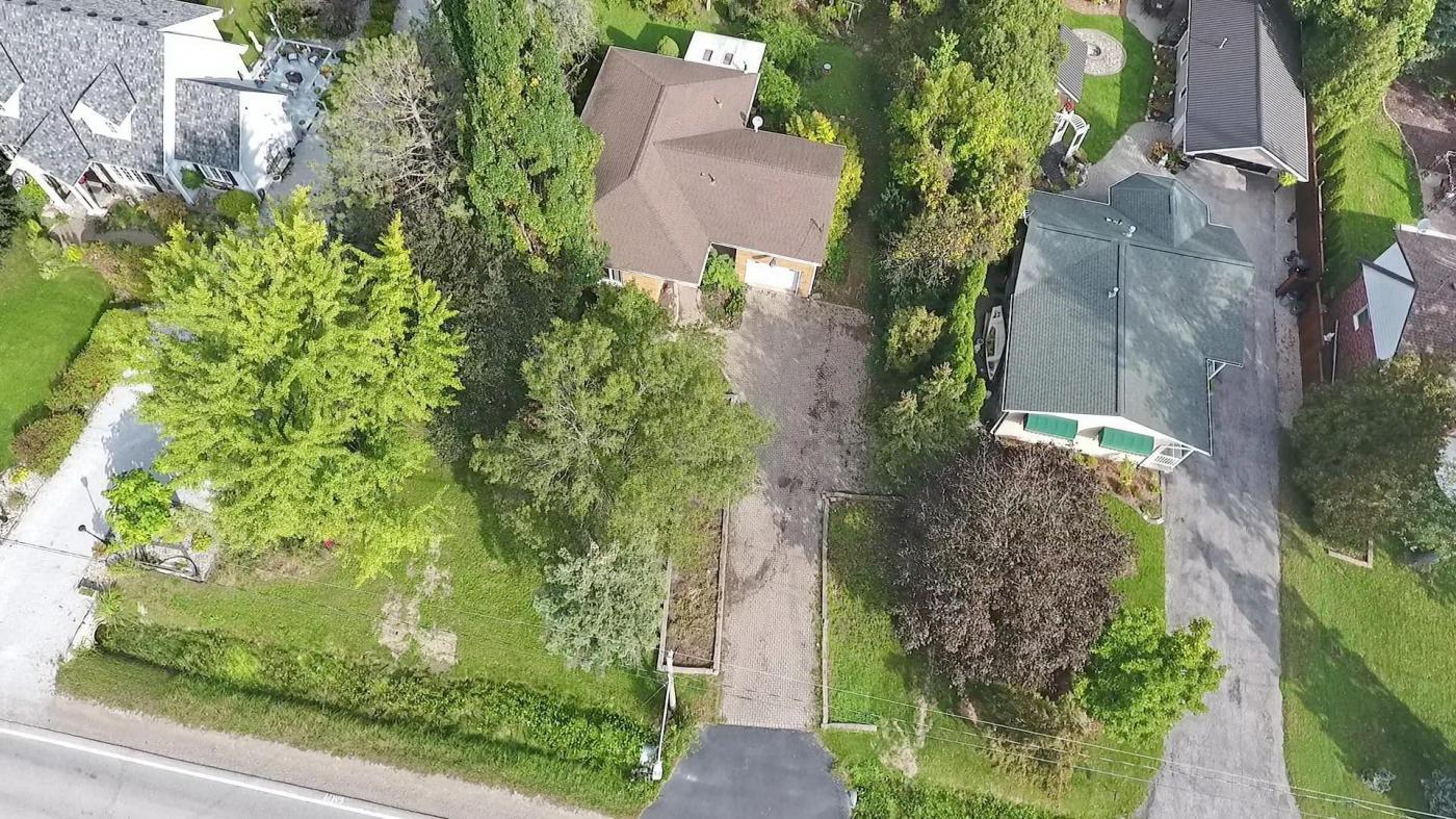Three bedroom Home on a very large treed lot.